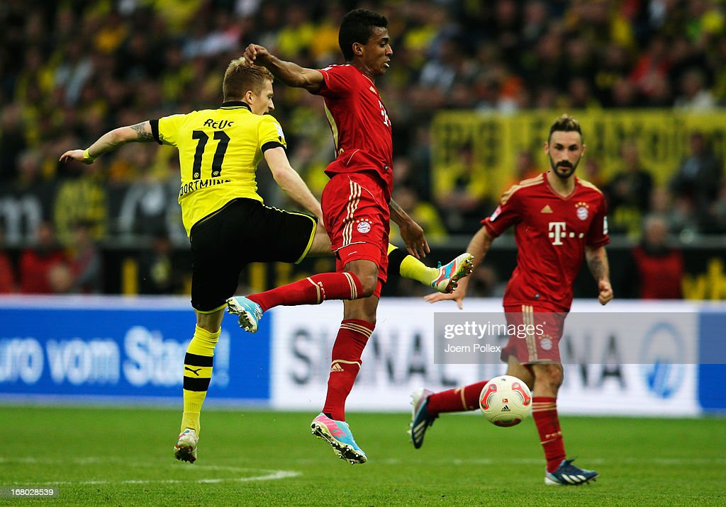 Marco Reus (L) of Dortmund challenges Luiz Gustavo of Muenchen during the Bundesliga match between Borussia Dortmund and FC Bayern Muenchen at Signal Iduna Park on May 4, 2013 in Dortmund, Germany.