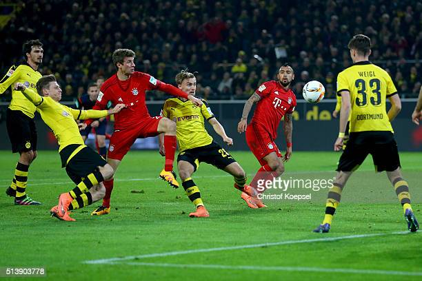 Marco Reus of Dortmund challenges Thomas Mueller of Bayern during the Bundesliga match between Borussia Dortmund and FC Bayern Muenchen at Signal...