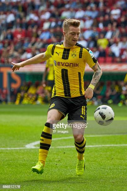 Marco Reus of Dortmund controls the ball during the Bundesliga match between FC Augsburg and Borussia Dortmund at the WWKArena on May 13 2017 in...