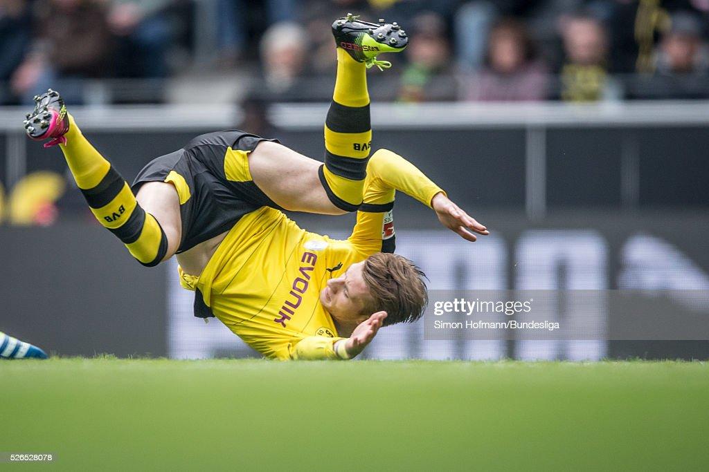 Marco Reus of Dortmund falls on the pitch during the Bundesliga match between Borussia Dortmund and VfL Wolfsburg at Signal Iduna Park on April 30, 2016 in Dortmund, North Rhine-Westphalia.