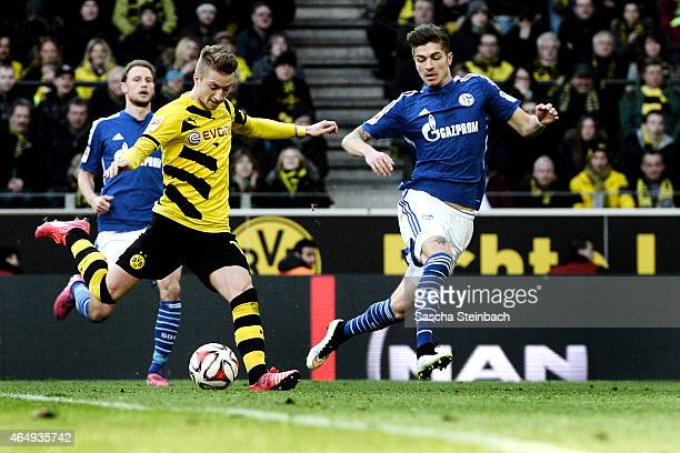 Marco Reus of Dortmund fires a shot towards the Schalke goal during the Bundesliga match between Borussia Dortmund and FC Schalke 04 at Signal Iduna...