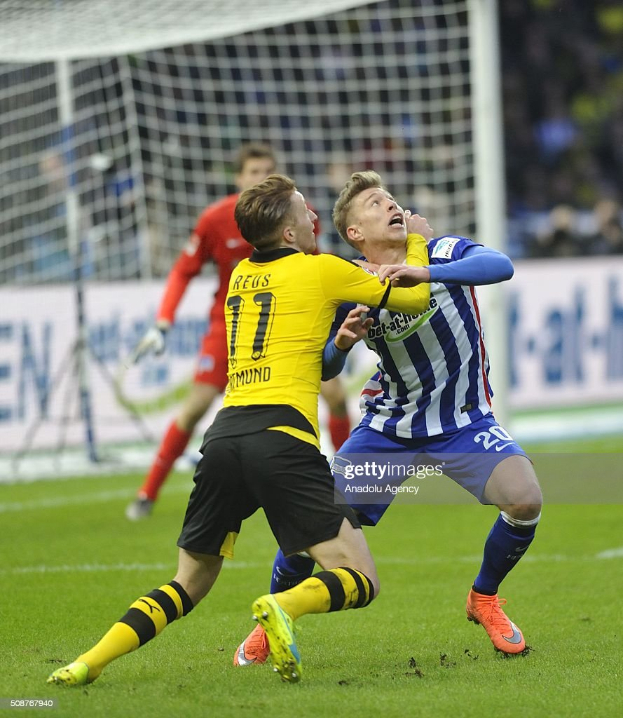 Marco Reus (L) of Dortmund in action against Mitchell Weiser (R) of Berlin during the Bundesliga match between Hertha BSC and Borussia Dortmund at Olympiastadion on February 6, 2016 in Berlin, Germany.