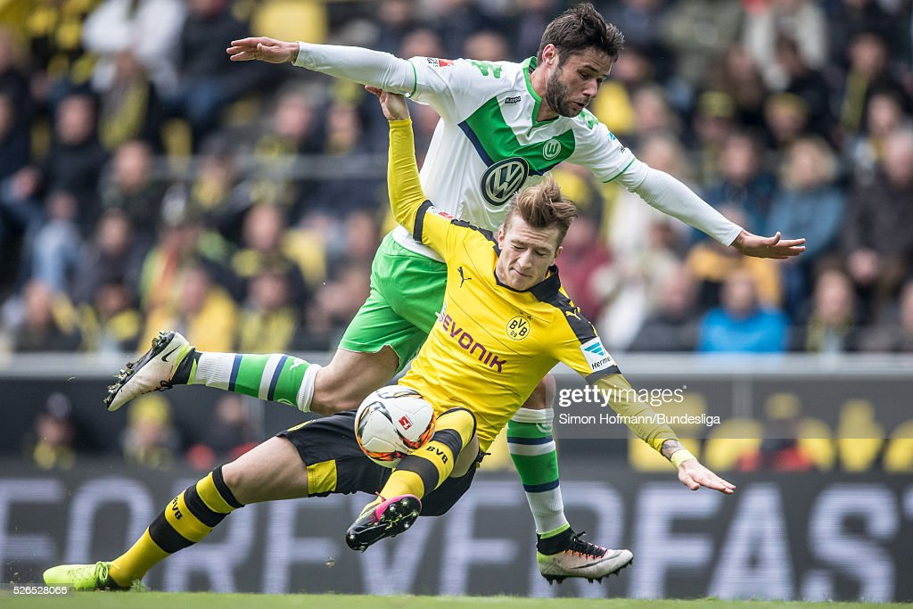 <a gi-track='captionPersonalityLinkClicked' href=/galleries/search?phrase=Marco+Reus&family=editorial&specificpeople=5445884 ng-click='$event.stopPropagation()'>Marco Reus</a> of Dortmund is challenged by <a gi-track='captionPersonalityLinkClicked' href=/galleries/search?phrase=Christian+Traesch&family=editorial&specificpeople=5482851 ng-click='$event.stopPropagation()'>Christian Traesch</a> of Wolfsburg during the Bundesliga match between Borussia Dortmund and VfL Wolfsburg at Signal Iduna Park on April 30, 2016 in Dortmund, North Rhine-Westphalia.