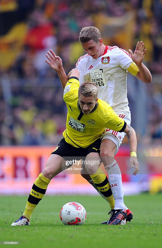 <a gi-track='captionPersonalityLinkClicked' href=/galleries/search?phrase=Marco+Reus&family=editorial&specificpeople=5445884 ng-click='$event.stopPropagation()'>Marco Reus</a> of Dortmund is challenged by <a gi-track='captionPersonalityLinkClicked' href=/galleries/search?phrase=Lars+Bender&family=editorial&specificpeople=644948 ng-click='$event.stopPropagation()'>Lars Bender</a> of Leverkusen during the Bundesliga match between Borussia Dortmund and Bayer 04 Leverkusen at Signal Iduna Park on September 15, 2012 in Dortmund, Germany.