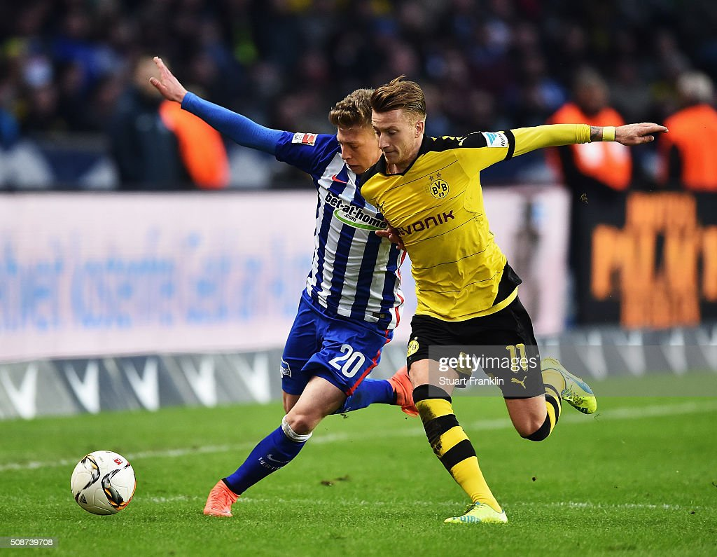 <a gi-track='captionPersonalityLinkClicked' href=/galleries/search?phrase=Marco+Reus&family=editorial&specificpeople=5445884 ng-click='$event.stopPropagation()'>Marco Reus</a> of Dortmund is challenged by <a gi-track='captionPersonalityLinkClicked' href=/galleries/search?phrase=Mitchell+Weiser&family=editorial&specificpeople=6732587 ng-click='$event.stopPropagation()'>Mitchell Weiser</a> of Berlin during the Bundesliga match bewteen Hertha BSC and Borussia Dortmund at Olympiastadion on February 6, 2016 in Berlin, Germany.