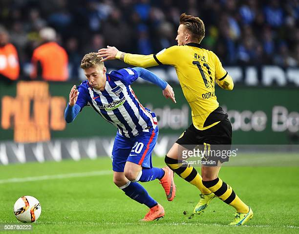 Marco Reus of Dortmund is challenged by Mitchell Weiser of Berlin during the Bundesliga match bewteen Hertha BSC and Borussia Dortmund at...