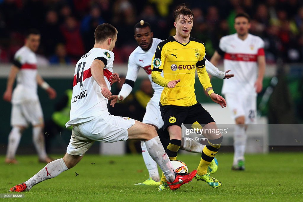 <a gi-track='captionPersonalityLinkClicked' href=/galleries/search?phrase=Marco+Reus&family=editorial&specificpeople=5445884 ng-click='$event.stopPropagation()'>Marco Reus</a> (R) of Dortmund is challenged by Toni Sunjic of Stuttgart during the DFB Cup Quarter Final match between VfB Stuttgart and Borussia Dortmund at Mercedes-Benz Arena on February 9, 2016 in Stuttgart, Germany.