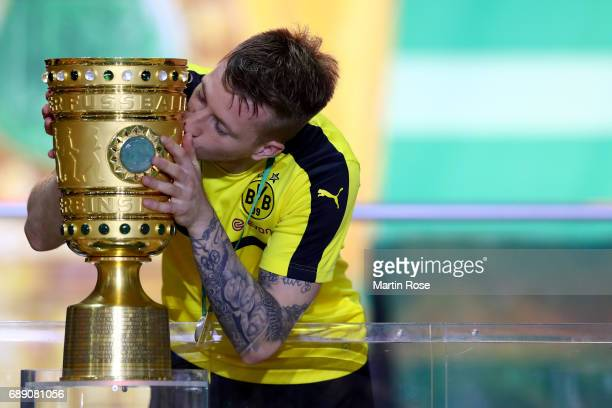 Marco Reus of Dortmund kisses the DFB cup trophy after the DFB Cup Final 2017 between Eintracht Frankfurt and Borussia Dortmund at Olympiastadion on...