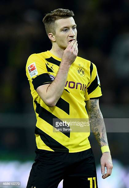 Marco Reus of Dortmund looks dejected during the Bundesliga match between Borussia Dortmund and FC Bayern Muenchen at Signal Iduna Park on April 4...