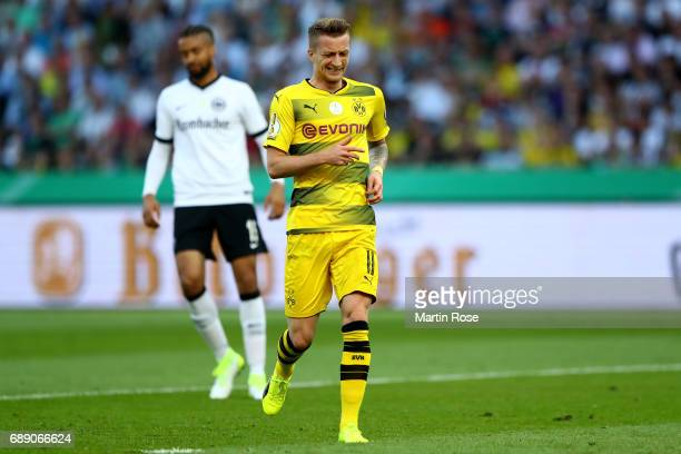 Marco Reus of Dortmund looks on during the DFB Cup final match between Eintracht Frankfurt and Borussia Dortmund at Olympiastadion on May 27 2017 in...
