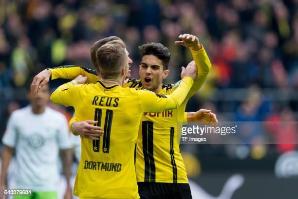 Marco Reus of Dortmund Lukasz Piszczek of Dortmund and Marc Bartra of Dortmund celebrate after scoring a goal during the Bundesliga match between...