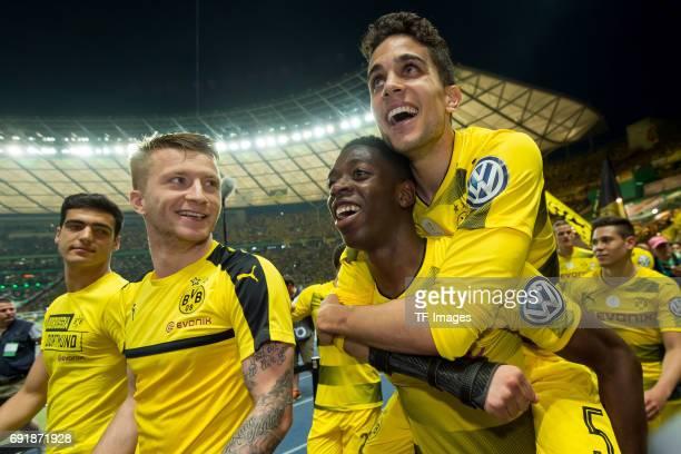Marco Reus of Dortmund Ousmane Dembele of Dortmund and Marc Bartra of Dortmund celebrates after winning the DFB Cup final match between Eintracht...