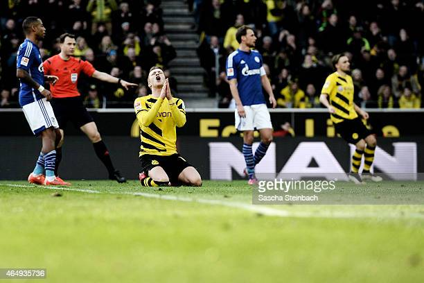 Marco Reus of Dortmund reacts after missing a chance at goal during the Bundesliga match between Borussia Dortmund and FC Schalke 04 at Signal Iduna...