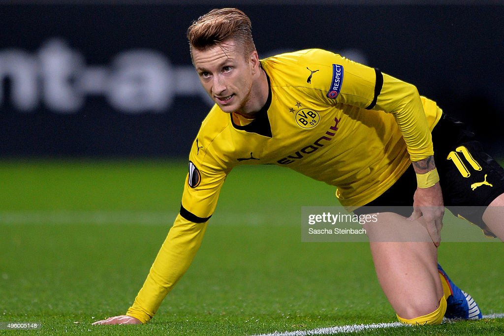 Marco Reus of Dortmund reacts after picking up an injury as he scores the opening goal during the UEFA Europa League group stage match between Borussia Dortmund and Qabala FK at Signal Iduna Park on November 5, 2015 in Dortmund, Germany.