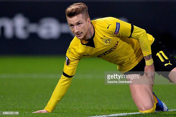 Marco Reus of Dortmund reacts after picking up an injury as he scores the opening goal during the UEFA Europa League group stage match between...