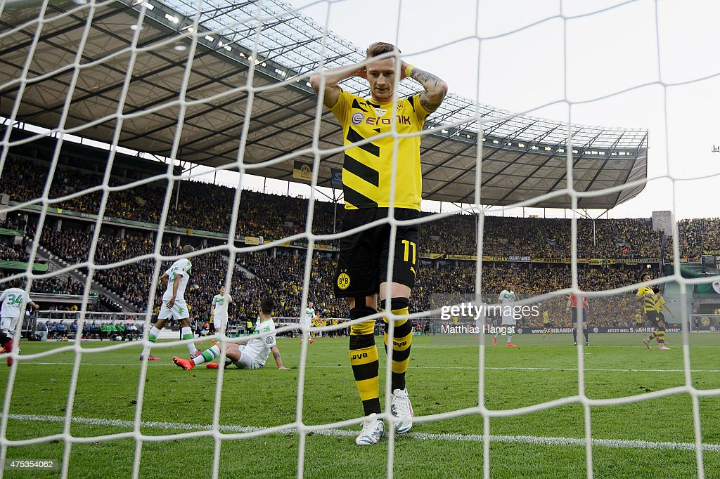 <a gi-track='captionPersonalityLinkClicked' href=/galleries/search?phrase=Marco+Reus&family=editorial&specificpeople=5445884 ng-click='$event.stopPropagation()'>Marco Reus</a> of Dortmund reacts during the DFB Cup Final match between Borussia Dortmund and VfL Wolfsburg at Olympiastadion on May 30, 2015 in Berlin, Germany.