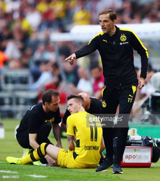 Marco Reus of Dortmund receives treatment during the DFB Cup Final between Eintracht Frankfurt and Borussia Dortmund at Olympiastadion on May 27 2017...