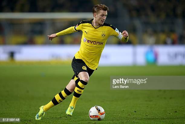 Marco Reus of Dortmund runs with the ball during the Bundesliga macth between Borussia Dortmund and 1899 Hoffenheim at Signal Iduna Park on February...
