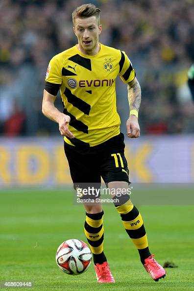 Marco Reus of Dortmund runs with the ball during the Bundesliga match between Borussia Dortmund and FC Bayern Muenchen at Signal Iduna Park on April...