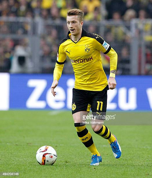 Marco Reus of Dortmund runs with the ball during the Bundesliga match between Borussia Dortmund and FC Augsburg at Signal Iduna Park on October 25...