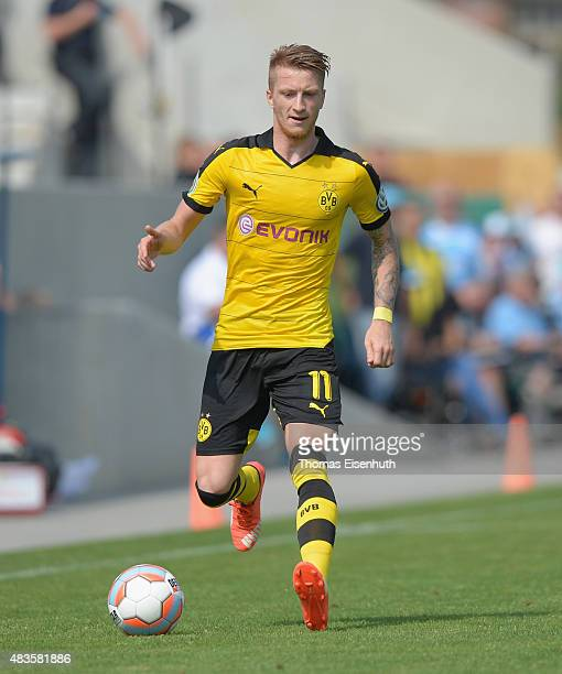 Marco Reus of Dortmund runs with the ball during the DFB Cup first round match between Chemnitzer FC and Borussia Dortmund at Stadion an der...