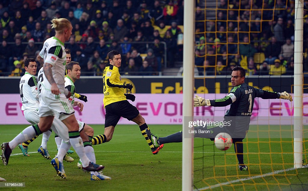<a gi-track='captionPersonalityLinkClicked' href=/galleries/search?phrase=Marco+Reus&family=editorial&specificpeople=5445884 ng-click='$event.stopPropagation()'>Marco Reus</a> of Dortmund scores his teams first goal past goalkeeper <a gi-track='captionPersonalityLinkClicked' href=/galleries/search?phrase=Diego+Benaglio&family=editorial&specificpeople=543817 ng-click='$event.stopPropagation()'>Diego Benaglio</a> of Wolfsburg during the Bundesliga match between Borussia Dortmund and VfL Wolfsburg at Signal Iduna Park on December 8, 2012 in Dortmund, Germany.