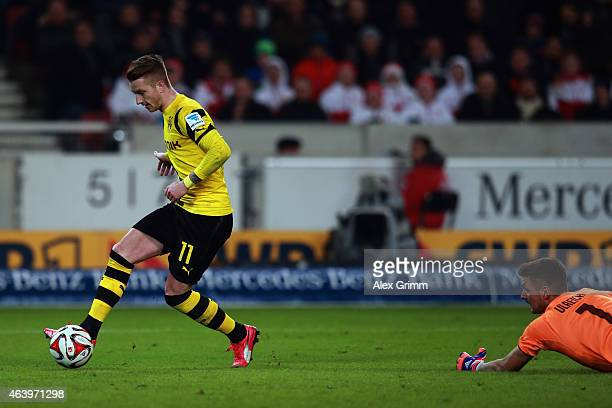 Marco Reus of Dortmund scores his team's third goal against goalkeeper Sven Ulreich of Stuttgart during the Bundesliga match between VfB Stuttgart...
