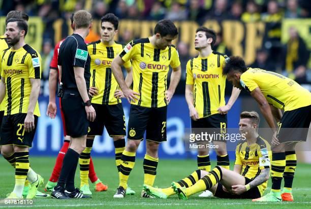 Marco Reus of Dortmund sits injured off the pitch during the Bundesliga match between Borussia Dortmund and Bayer 04 Leverkusen at Signal Iduna Park...