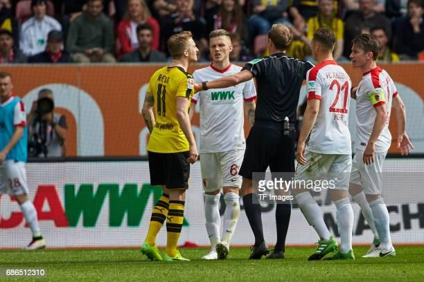 Marco Reus of Dortmund speak with Paul Verhaegh of Augsburg during the Bundesliga match between FC Augsburg and Borussia Dortmund at the WWKArena on...