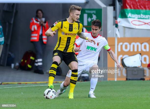 Marco Reus of Dortmund und Paul Verhaegh of Augsburg battle for the ball during the Bundesliga match between FC Augsburg and Borussia Dortmund at the...