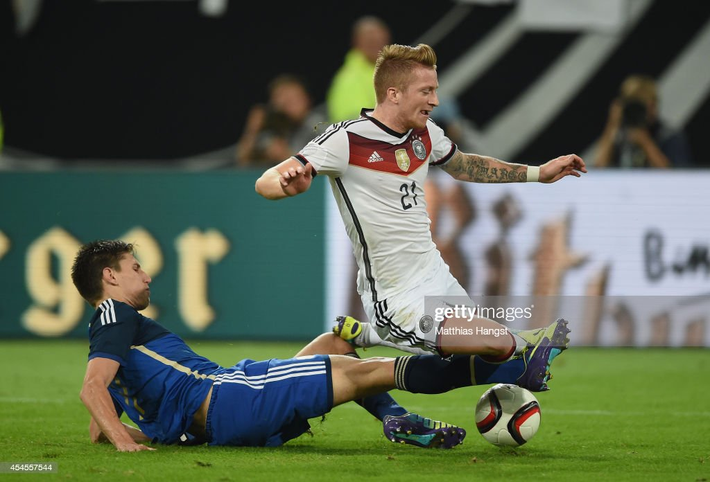 <a gi-track='captionPersonalityLinkClicked' href=/galleries/search?phrase=Marco+Reus&family=editorial&specificpeople=5445884 ng-click='$event.stopPropagation()'>Marco Reus</a> (R) of Germany and Federico Fernandez (L) of Argentina compete for the ball during the international friendly match between Germany and Argentina at Esprit-Arena on September 3, 2014 in Duesseldorf, Germany.