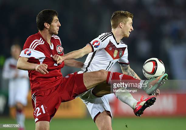 Marco Reus of Germany and Lasah Dvali of Georgia compete for the ball during the EURO 2016 Group D Qualifier match between Georgia and Germany at...