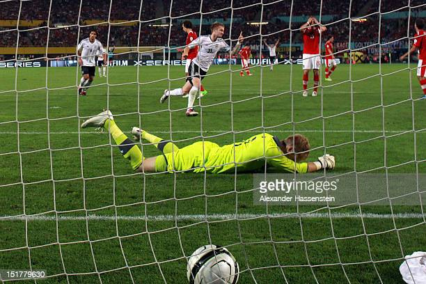 Marco Reus of Germany celebrates scoring the first goal against keeper Robert Almer of Austria during the FIFA 2014 World Cup Qualifier group C match...
