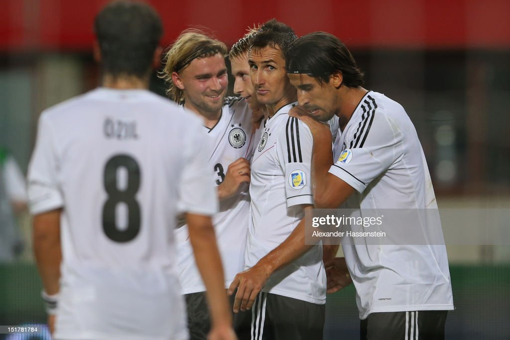<a gi-track='captionPersonalityLinkClicked' href=/galleries/search?phrase=Marco+Reus&family=editorial&specificpeople=5445884 ng-click='$event.stopPropagation()'>Marco Reus</a> (C) of Germany celebrates scoring the first team goal with his team mates during the FIFA 2014 World Cup Qualifier group C match between Austria and Germany at Ernst Happel Stadion on September 11, 2012 in Vienna, Austria.