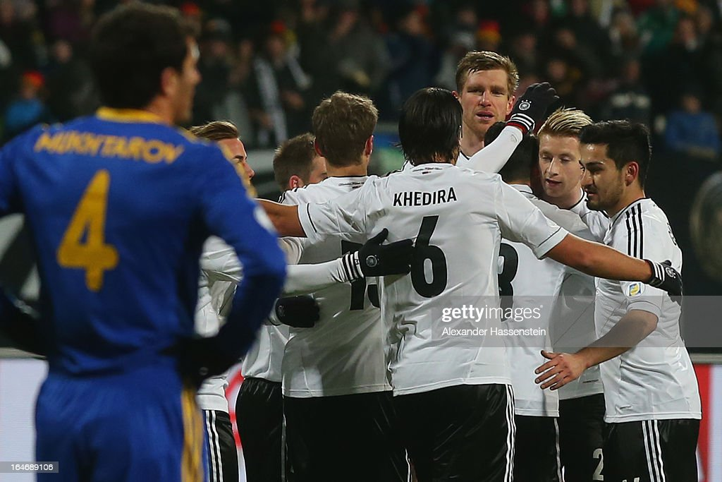 Marco Reus (2nd R) of Germany celebrates scoring the openin goal with his team mates during the FIFA 2014 World Cup qualifier group C match between Germany and Kazakhstan at Gundig-Stadion on March 26, 2013 in Nuremberg, Germany.