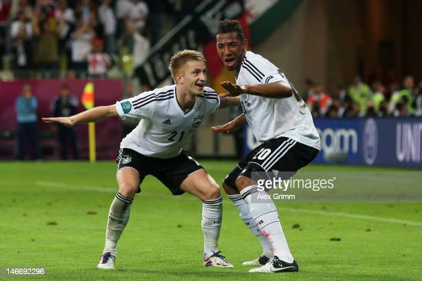 Marco Reus of Germany celebrates scoring their fourth goal with Jerome Boateng of Germany during the UEFA EURO 2012 quarter final match between...