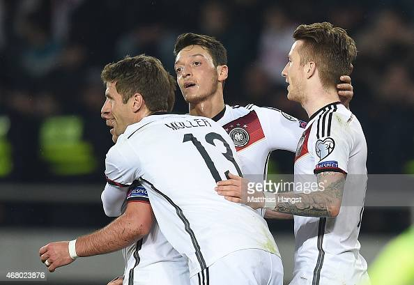 Marco Reus of Germany celebrates with his teammate after scoring his team's first goal during the EURO 2016 Group D Qualifier match between Georgia...