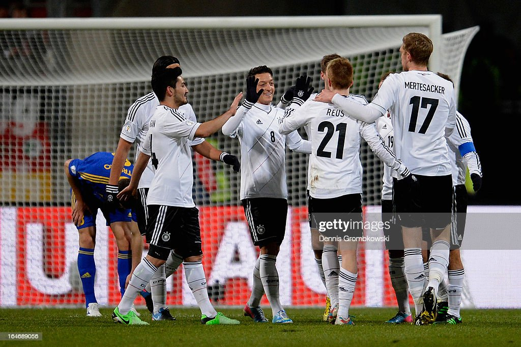 <a gi-track='captionPersonalityLinkClicked' href=/galleries/search?phrase=Marco+Reus&family=editorial&specificpeople=5445884 ng-click='$event.stopPropagation()'>Marco Reus</a> of Germany celebrates with teammates after scoring the first goal during the FIFA 2014 World Cup Qualifier match between Germany and Kazakhstan at Grundig-Stadion on March 26, 2013 in Nuremberg, Germany.