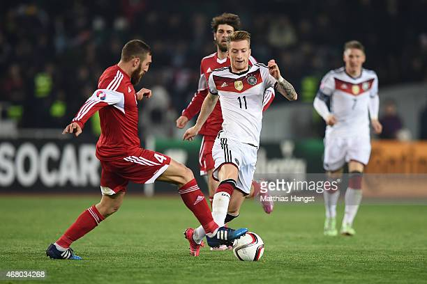 Marco Reus of Germany controls the ball against Guram Kashia of Georgia during the EURO 2016 Group D Qualifier match between Georgia and Germany at...