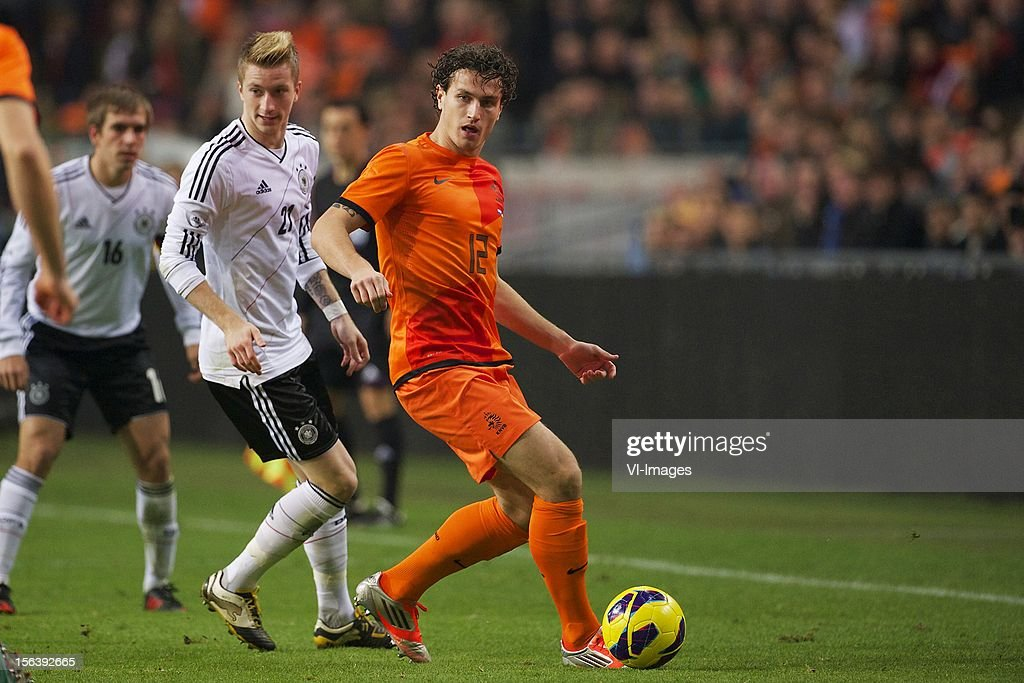 Marco Reus of Germany, Daryl Janmaat of Holland during the Friendly match between Holland and Germany at the Amsterdam Arena on November 14, 2012 in Amsterdam, The Netherlands.