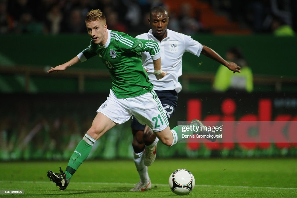 <a gi-track='captionPersonalityLinkClicked' href=/galleries/search?phrase=Marco+Reus&family=editorial&specificpeople=5445884 ng-click='$event.stopPropagation()'>Marco Reus</a> of Germany is chased by Eric Abidal of France during the International friendly match between Germany and France at Weser Stadium on February 29, 2012 in Bremen, Germany.