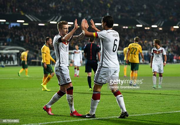 Marco Reus of Germany is congratulated by teammate Sami Khedira after scoring the opening goal during the International Friendly match between...