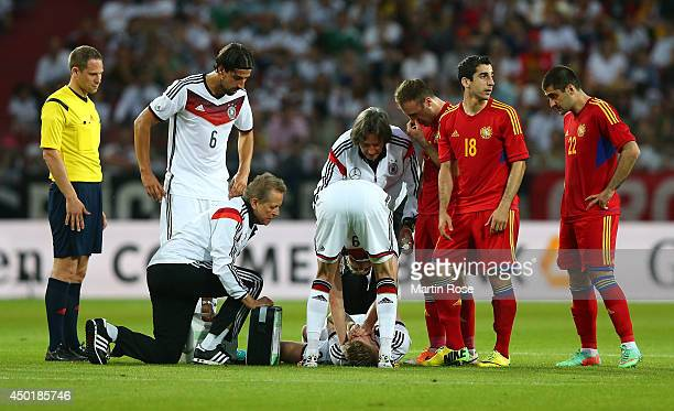 Marco Reus of Germany lies injured on the pitch during the International Friendly Match between Germany and Armenia at coface Arena on June 6 2014 in...