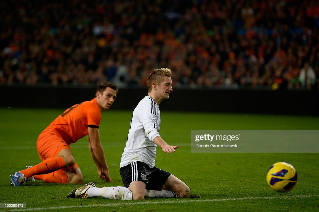 <a gi-track='captionPersonalityLinkClicked' href=/galleries/search?phrase=Marco+Reus&family=editorial&specificpeople=5445884 ng-click='$event.stopPropagation()'>Marco Reus</a> of Germany reacts after being challenged by Stefan de Vrij of Netherlands during the International Friendly match between Netherlands and Germany at Amsterdam Arena on November 14, 2012 in Amsterdam, Netherlands.