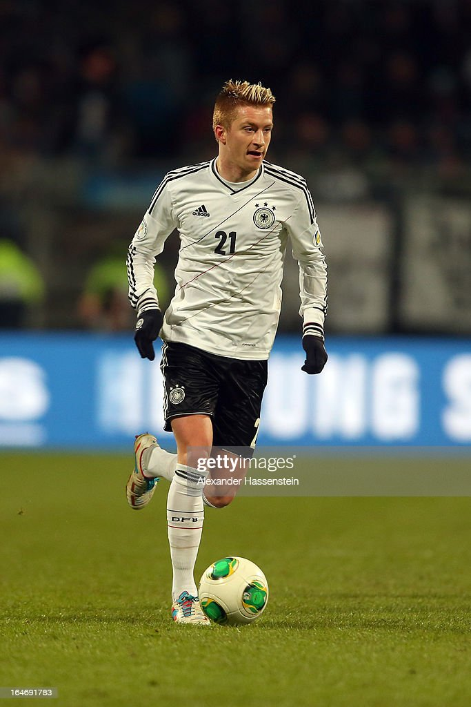 Marco Reus of Germany runs with the ball during the FIFA 2014 World Cup qualifier group C match between Germany and Kazakhstan at Gundig-Stadion on March 26, 2013 in Nuremberg, Germany.
