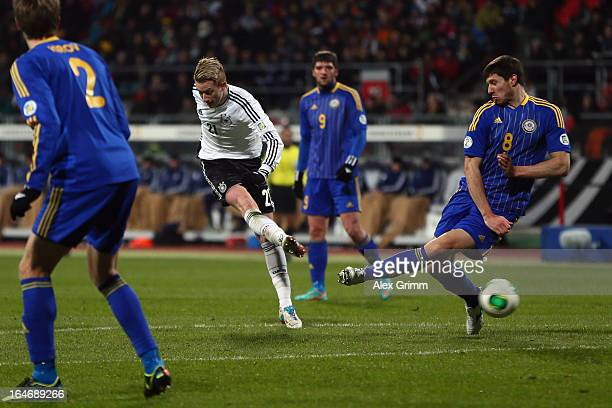 Marco Reus of Germany scores his team's first goal against Viktor Dmitrenko of Kazakhstan during the FIFA 2014 World Cup qualifier between Germany...