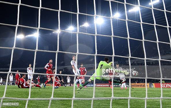 Marco Reus of Germany scores his team's first goal during the EURO 2016 Group D Qualifier match between Georgia and Germany at Boris Paichadze...
