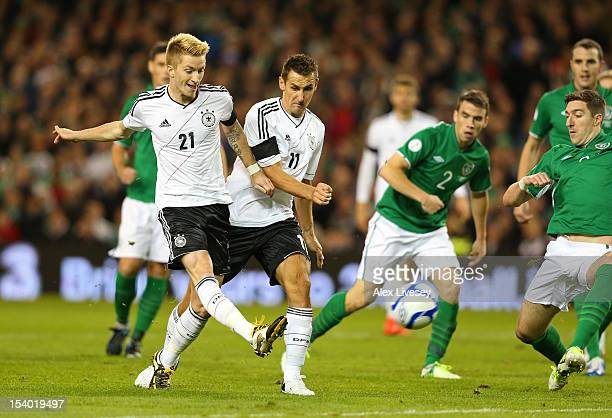Marco Reus of Germany scores the opening goal during the FIFA 2014 World Cup Qualifier Group C match between Republic of Ireland and Germany at the...