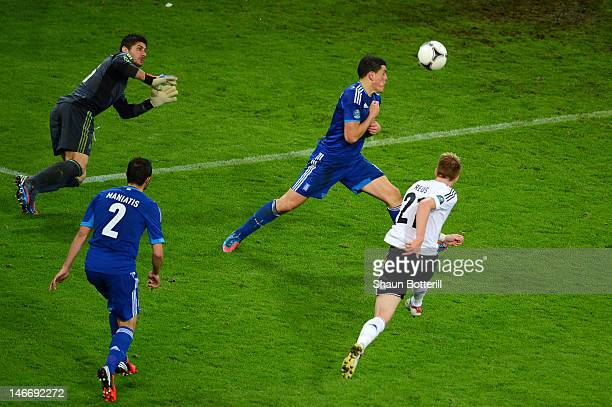 Marco Reus of Germany scores their fourth goal during the UEFA EURO 2012 quarter final match between Germany and Greece at The Municipal Stadium on...