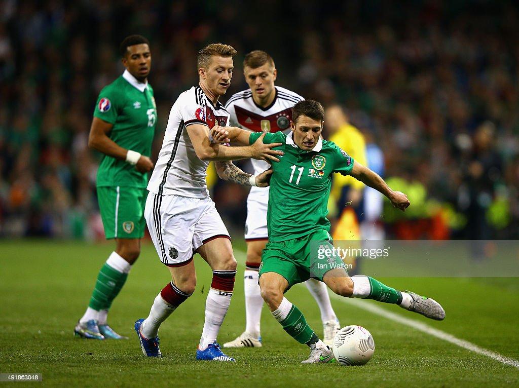 Marco Reus of Germanytackles Wes Hoolahan of Republic of Ireland during the UEFA EURO 2016 Qualifier group D match between Republic of Ireland and...